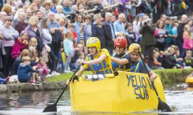 Homemade vessels compete in cardboard boat race