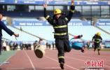 """南京举办消防站比武竞赛 提升""""火场战斗力""""(组图)"""