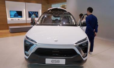 Electric vehicle startups seek stock market cash for bold plans